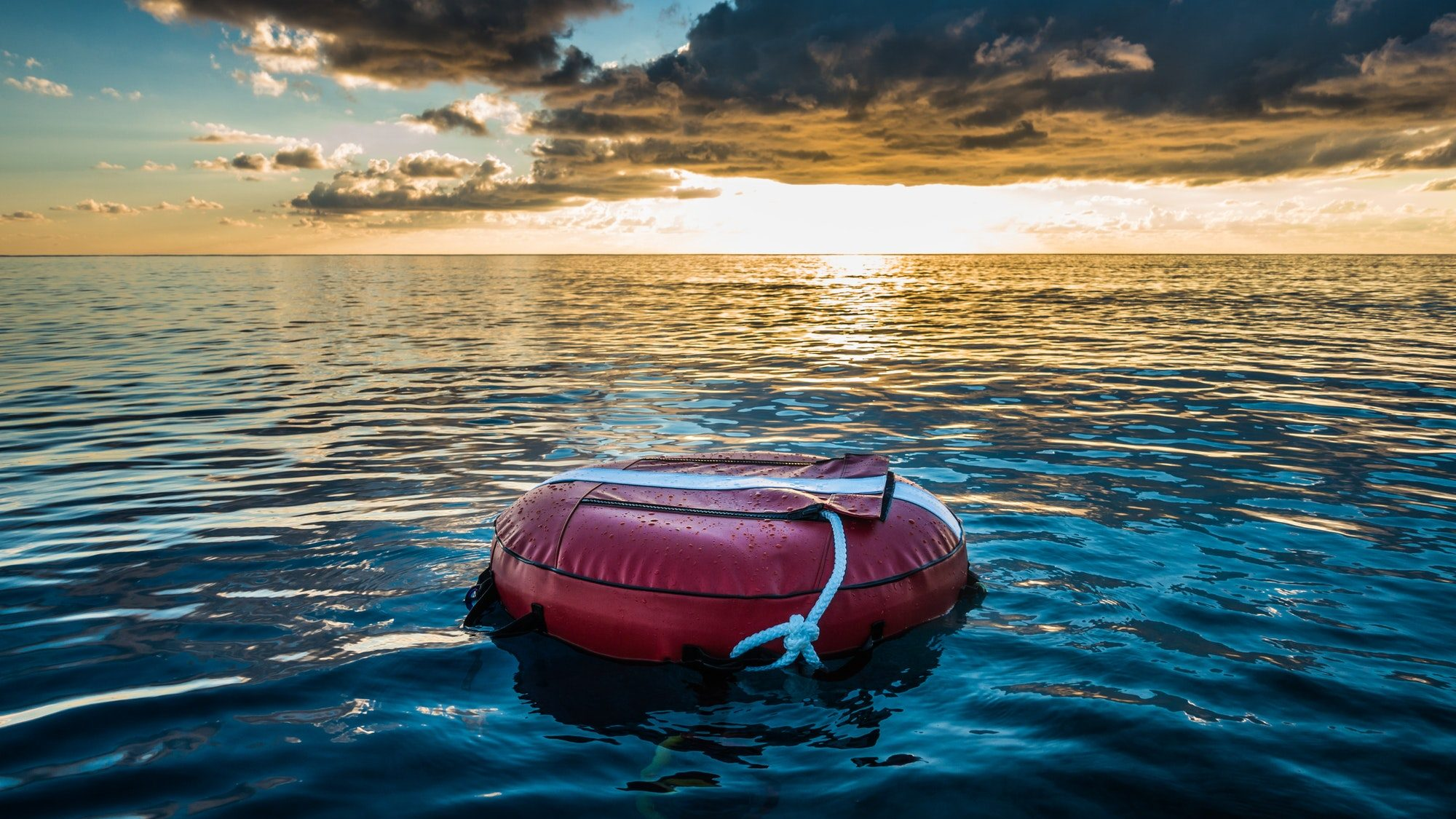 Red buoy for freediving floating in the ocean.